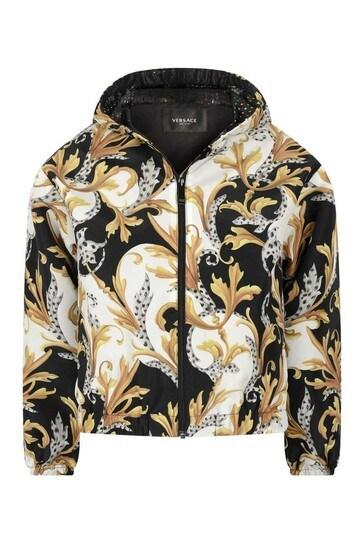 소년 화이트 블랙 과 골드 재킷