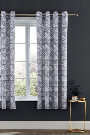 Art Deco Geo Lined Eyelet Curtains by Catherine Lansfield