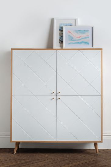 Moritz 4 Door Cabinet Oak by Julian Bowen