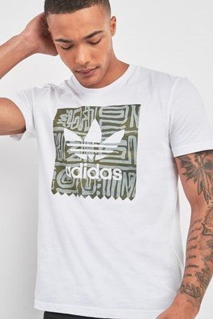 91a16f8f98e Buy adidas Originals White Logo Dakari Tee from Next Bahrain