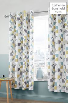 Retro Circles Lined Eyelet Curtains by Catherine Lansfield