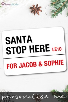 multi personalised santa stop here sign by loveabode