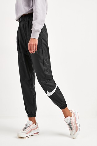 galón Disparo padre  Buy Nike Swoosh Woven Joggers from the Next UK online shop