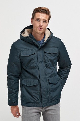 Navy Shower Resistant Borg Lined Four Pocket Jacket With Storm Cuffs