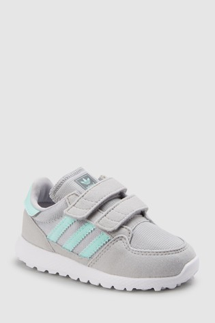 6a657619e Buy adidas Originals Grey Mint Forest Grove Infant from Next Italy