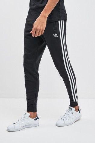208e356fb Buy adidas Originals 3 Stripe Joggers from the Next UK online shop