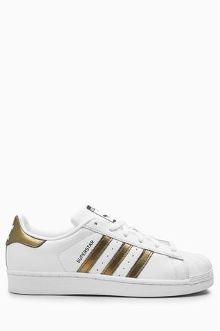 hienoin valinta uusi muotoilu klassinen istuvuus adidas Originals White/Gold Superstar Trainers