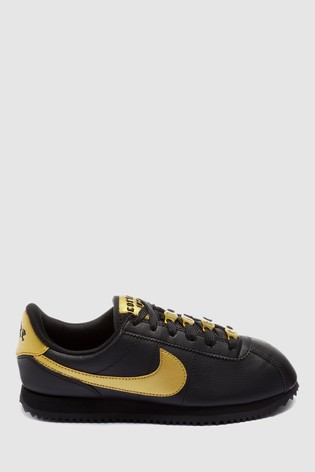 best service c5216 f1bf5 Nike Black/Gold Cortez Youth Trainers