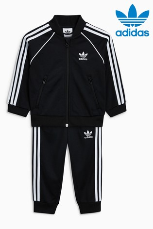 cea758579 Buy adidas Originals Baby Black 3 Stripe Tracksuit from the Next UK ...