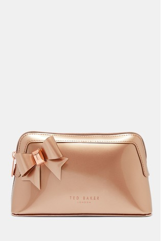 24d980e87 Buy Ted Baker Aubrie Rose Gold Bow Make Up Bag from the Next UK ...