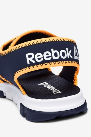 be1fb4336e9 Buy Reebok Navy Orange Wave Glider III from the Next UK online shop