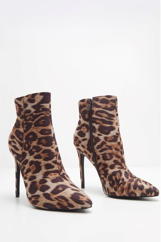 f1441bf0032 Buy PrettyLittleThing Leopard Print Heeled Ankle Boots from the Next ...