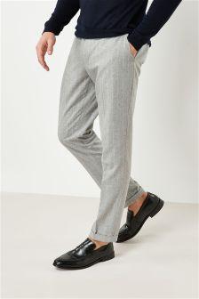 Костюмные брюки зауженного кроя в полоску