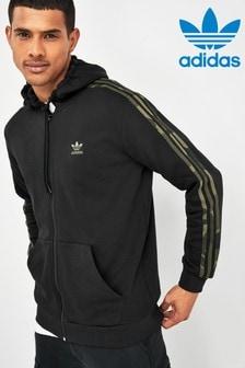 קפוצ'ון מרוכסן עם3 פסים בדוגמת הסוואה בשחור של adidas Originals