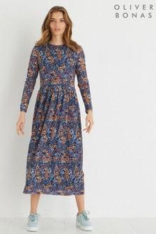 Niebieska sukienka midi z kwiatowym nadrukiem i siateczką Oliver Bonas