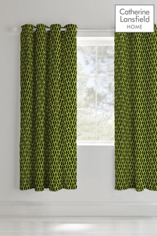 Neon Football Lined Eyelet Curtains by Catherine Lansfield