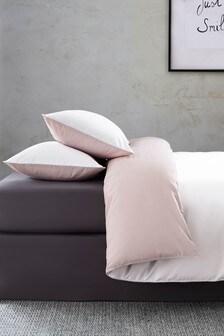 Zweifarbiges Set mit wendbaren Bett- und Kissenbezügen