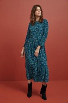 Многоярусное платье с анималистическим принтом