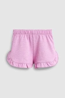 Pantaloni scurți cu volane (3 luni - 7 ani)