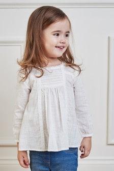 חולצת תחרה עם קפלים (3 חודשים-7 שנים)