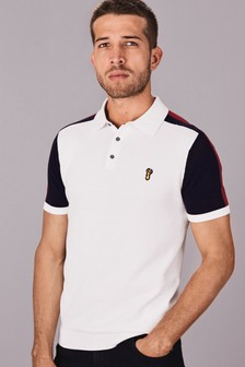 Polo motif colour block aux épaules