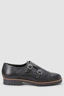 Кожаные туфли с пряжками на массивной подошве