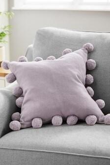 Poduszka z pomponami przy brzegach