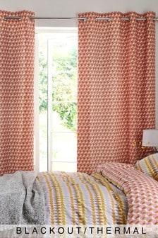 Затемняющие шторы цвета охры в разноцветный горошек с люверсами