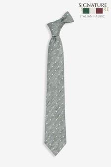 Фирменный галстук итальянского производства в белый горошек с добавлением шелка