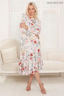 שמלה בדוגמה אסימטרית עם פרחים של Gina Bacconi דגם Estrella בלבן