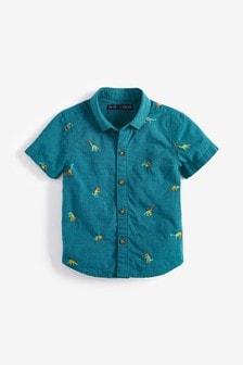 Camicia a maniche corte con dinosauri ricamati (3 mesi - 7 anni)