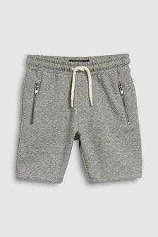 מכנסיים קצרים עם כיסים הנסגרים ברוכסן (גילאי 3 עד 16)