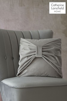 Velvet Bow Cushion by Catherine Lansfield