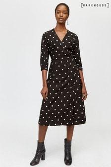 Czarna sukienka midi z nadrukiem kropek Warehouse