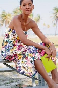 Květovaná kombinéza s kalhotovou sukní