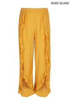 Желто-коричневые широкие брюки с оборками River Island