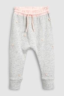 Pantaloni de trening cu ciucuri (3 luni - 6 ani)
