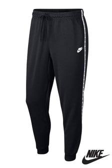 Spodnie dresowe z paskami po bokach Nike
