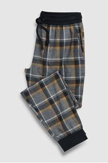 Текстильные штаны в клетку на манжетах