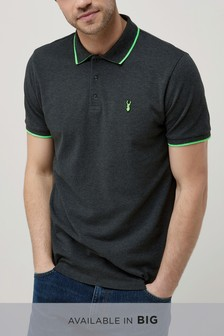 חולצת פולו עם סמל בשוליים בצבע ניאון