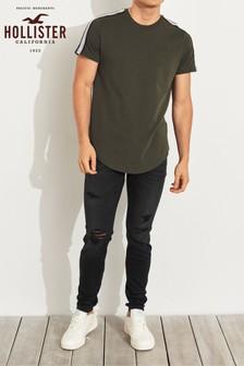Черные супероблегающие джинсы с рваной отделкой Hollister