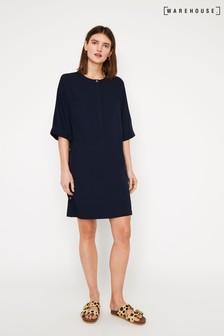 שמלת מיני כחולה בגזרה משוחררת עם כפתורים בצדדים של Warehouse