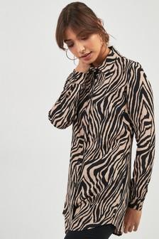4fc2a6395e2 Cream · Rust · Zebra Print Longline Shirt