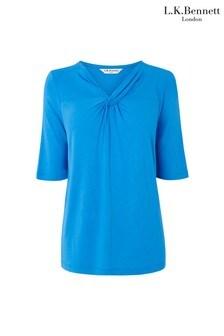 חולצה כחולה עם צווארון טוויסט של L.K.Bennett