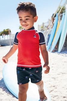 סט חולצה ומכנסיים קצרים לשחייה (3 חודשים-7 שנים)