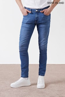 جينز ضيق أزرق متوسط من River Island