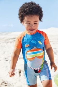Traje protector solar con tiburón (3 meses-7 años)