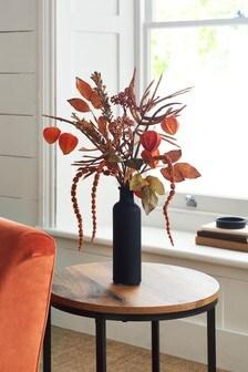Herbstliches Kunstblumenarrangement in Flasche
