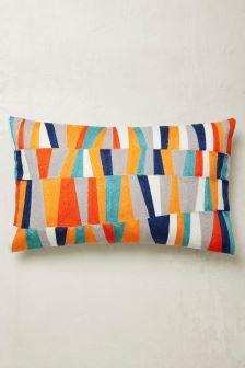 Cojín con textura tramada y diseño de patchwork
