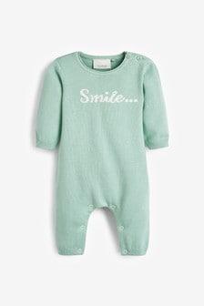 אוברול סרוג מבד אורגני באישור GOTS עם כיתוב Smile (0-12 חודשים)
